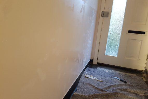 Wanden na herstellen voor het latex spuitwerk