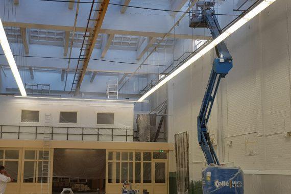 Latex spuiten van wanden en plafonds in bedrijfshallen door Voordelig Latex Spuiten