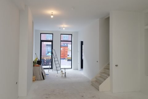 Latex spuiten nieuwbouw woning Rotterdam