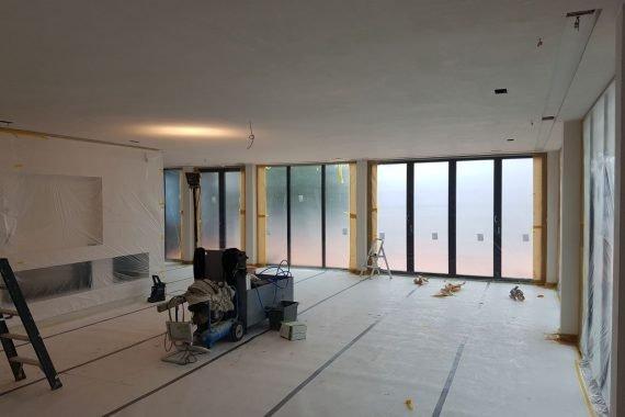 Woonkamer voor het spuiten van wanden en plafonds